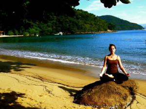 Ardha Padmsana Yoga Beach Island Retreat Green Stone Journeys Wellness Tours Ilha Grande